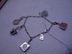 Silver charm bracelet set with numerous charms,
