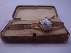 9ct gold Vintage Ladies wrist watch on 9ct gold mesh strap, 15.6 grams in total working order,
