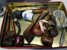 Selection of vintage pipes and pipe cleaners