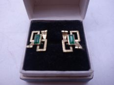 Pair of un-marked 14ct GOLD and emerald stud earrings, stylized design with emerald set to each