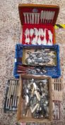 QUANTITY OF MIXED STAINLESS STEEL WOODEN HANDLE CUTLERY AND A BOXED CUTLERY SET