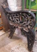 A PAIR OF VERY HEAVY CAST IRON BENCH ENDS