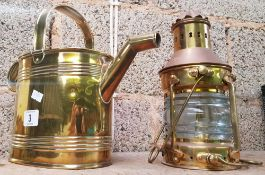BRASS WATERING CAN BY ADAMS & SON, LONDON. AND MODERN BRASS AND COPPER OIL MAST HEADLIGHT