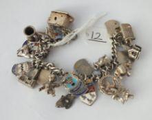 A silver charm bracelet - 67gms