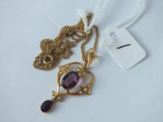 An attracive amethyst & pearl drop pendant necklace in 9ct on a rolled gold gilt link chain