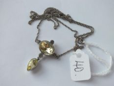 An antique paste drop pendant, silver mounted & on a silver chain