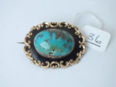 A gold mounted turquoise enamel brooch