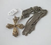 A silver guard chain with a cross
