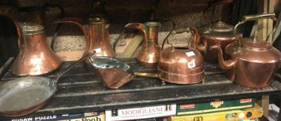 SHELF WITH 3 COPPER MIDDLE EASTERN WATER JUGS, COPPER FRYING PAN, 3 COPPER KETTLES & A COPPER SCOOP