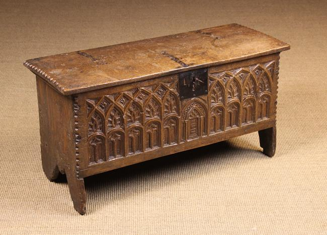 Lot 133 - A Small 16th Century Boarded Oak Coffer with Gothic style carving.