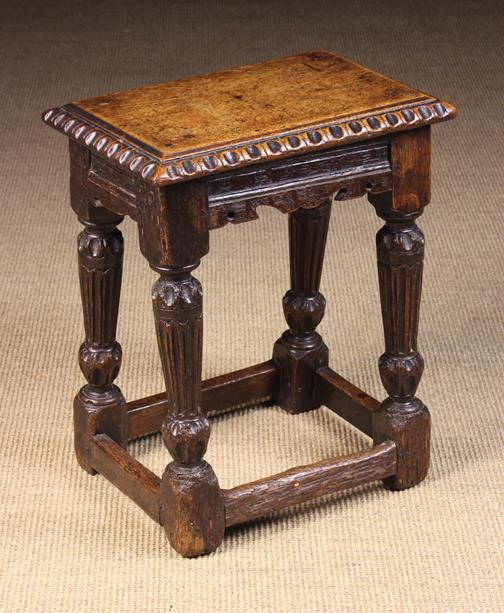 Lot 550 - A Late 16th/Early 17th Century Carved Oak Joint Stool with later top.