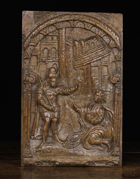 Lot 223 - A Fine Oak Relief-Carved Panel depicting the Return of the Prodigal Son, Circa 1600.