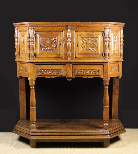 Lot 547 - A 16th Century and Later Renaissance Carved Oak & Fruitwood Buffet of canted form.