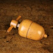 "A Fine 19th Century Boxwood ""Urn"" Shaped Lemon Squeezer, with a screw off upper half,"