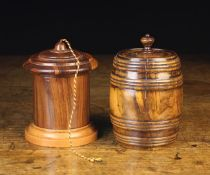 Two 19th Century Treen Containers: A turned figured walnut barrel shaped tobacco jar with ring