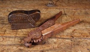 A Pair of Late 19th Century Chip Carved Treen Nut-Crackers and a naively cut animal form snuff box