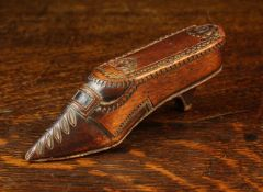 A Late 19th Century Carved Treen Snuff Box in the form of a lady's shoe, with chip carved vamp,