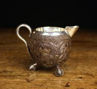 An Eastern Silver Metal Mounted Coconut Shell Jug.