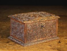 A Small 18th Century Casket of rectangular form intricately carved in the manner of Cesar Bagard,