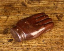 A Treen Snuff Box carved in the form of a hand with a hinged pewter lid to the palm,