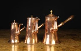 A Group of Three 18th Century Copper Hot Chocolate Pots each with a with turned wooden side handle,
