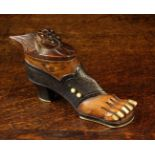 A Carved Treen Snuff Box in the form of a lady's foot wearing an open toed shoe with inset bone