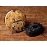 An 18th Century Horn Snuff Box of flat, circular form.