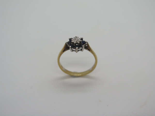 Lot 756 - An 18ct gold and white stone eternity ring with a stone missing and rubbing to others, size P, and