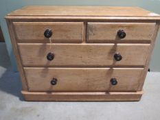 A 19th century pine chest with two short over two long drawers, 108cm wide x 75cm high