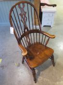 A 20th century broad arm elbow Windsor armchair, 120cm tall, in good polished condition
