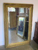A large gilt over mantle mirror, 144cm x 97cm