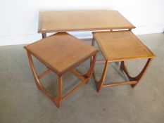 A nest of three G plan side tables, 51cm tall x 99cm x 49cm, in generally good condition with some