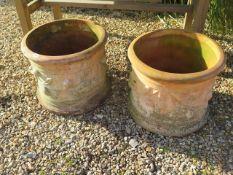 A pair of large terracotta planters, 42cm tall x 50cm diameter
