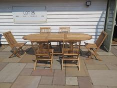 A new teak garden table and 6 folding chairs. Table size extends from 180cm to 240cm with single