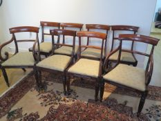 A set of eight early 19th century mahogany bar back dining chairs, including two carvers with