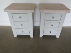 A pair of painted three drawer bedside chests with chalked oak tops, 62cm high x 47cm wide, ex-
