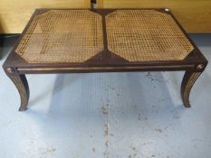 A mahogany and gilt bergere stool in the Regency style, 39cm tall x 100cm x 66cm top