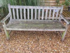 A garden bench in sound condition, 152cm wide