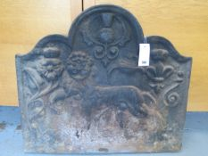 An 18th century style cast iron fireback, 20th century relief cast with lion, tudric rose and