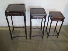 A nest of three Oriental carved sidetables in good sturdy condition, minor cracking to tops, 67cm