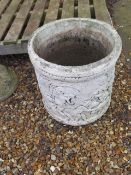 A stone effect garden planter, 44cm tall x 42cm