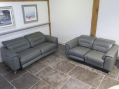 Two Furniture Village soft grey leather seater sofas with electric adjustable head and foot rests