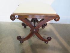 A 19th century rosewood cross frame stool in good condition, recently reupholstered, 42cm tall x