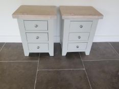 A pair of chalked oak bedside tables, 62cm high x 47cm x 37cm