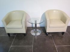 A pair of faux leather cream tub chairs with a glass top coffee table, 49cm tall x 53cm, some