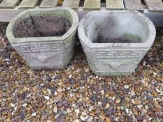 A pair of stone effect garden planters, 27cm tall x 37cm wide