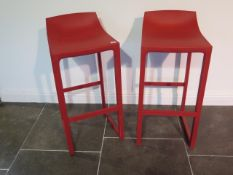 A pair of Vondow Wall St by Eugeni Quitllet red moulded bar stools, 87cm tall x 39cm wide, for