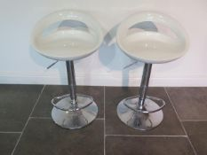 A pair of gas lift bar stools with moulded seats, some usage marks but working