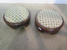 A pair of Victorian footstools with woolwork covers, 12cm tall x 30cm diameter