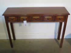 A five drawer mahogany hall table made by a local craftsman to a high standard, 76cm tall x 107cm